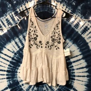 Brand new off white tank top with flower design